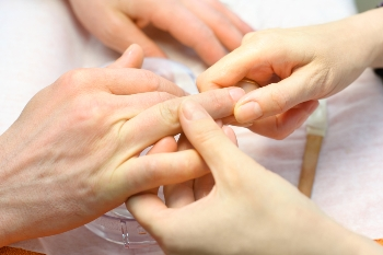 Image of male hands receiving a manicure